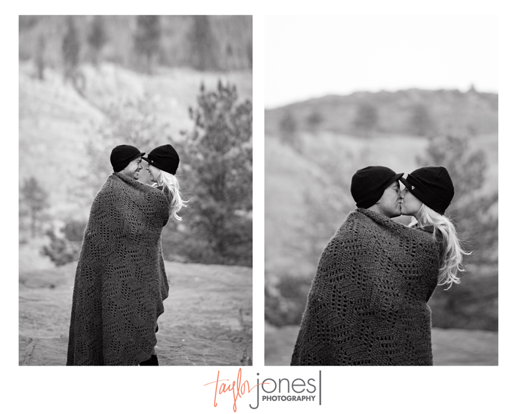 Couple wrapped in a blanket at their engagement shoot.