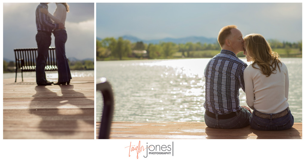 Couple kissing on a dock at their Denver, Colorado engagement shoot. Rocky Mountains in the background