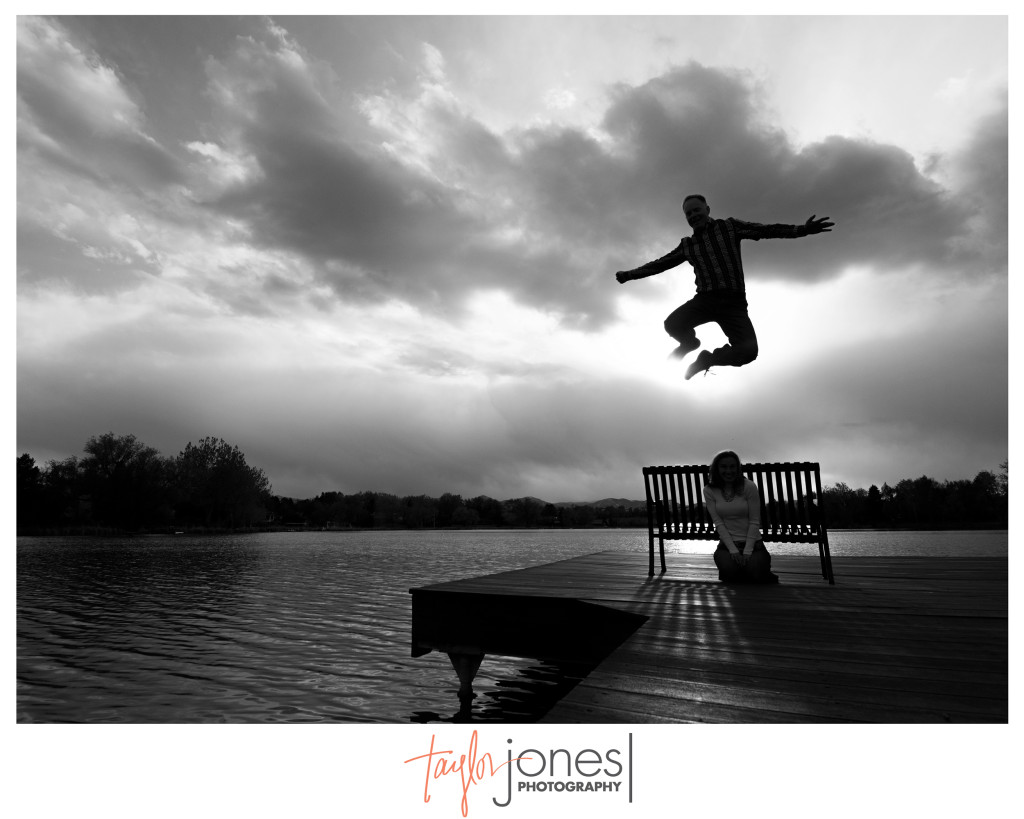 Couple jumping off a dock in Denver at their engagement shoot, shot with Tokina wide angle 11-16mm lens