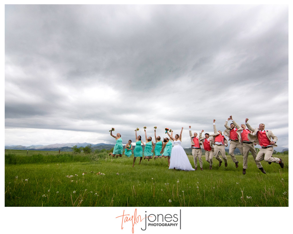 Bridal party jumping during a storm at in Longmont, Colorado
