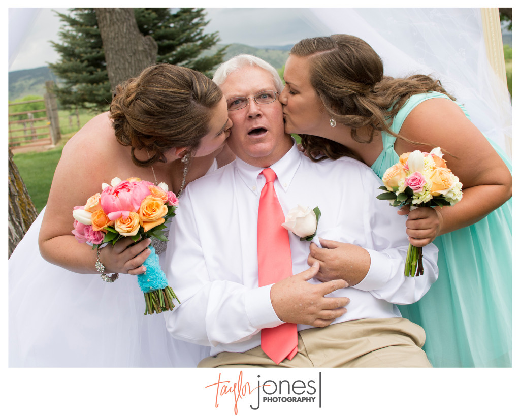 Bride and sister kissing their dad