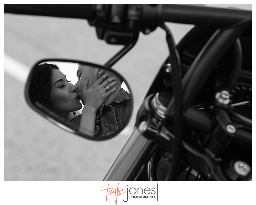 Mirror shot of engagement shoot with motorcycle