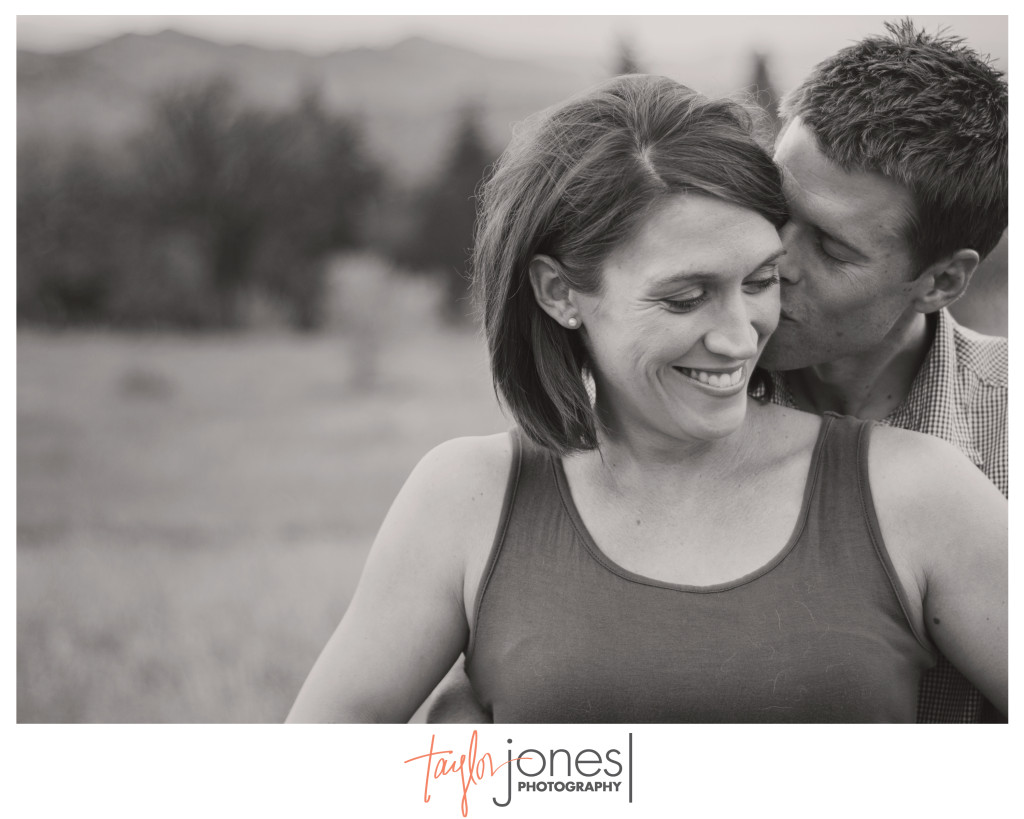 Mat and Kelly at their maternity shoot, laughing at Chautauqua Park