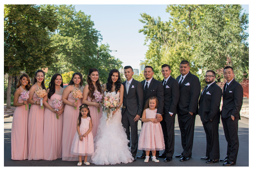 Bridal party posing in the street downtown Denver wedding