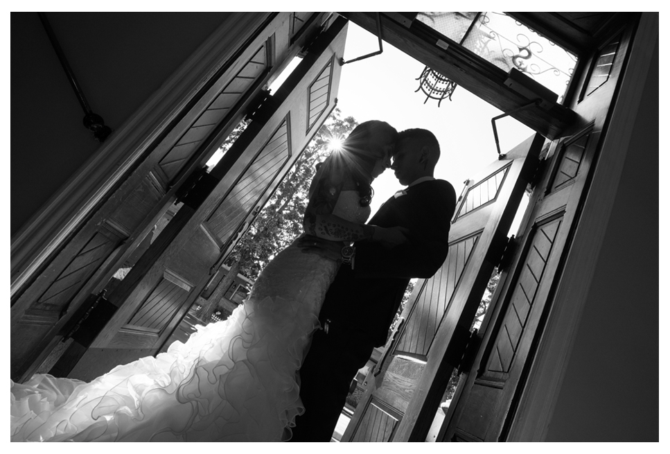 Bride and groom silhouette at Catholic church