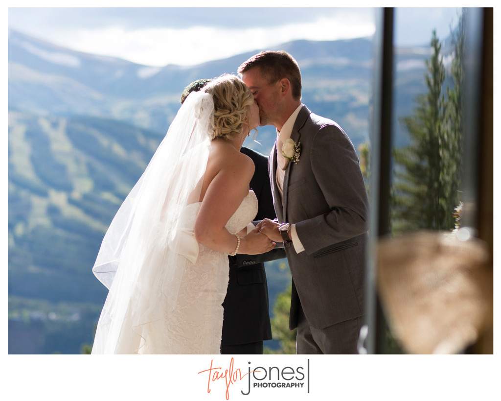 First kiss with Breckenridge ski resort in background, moutain wedding