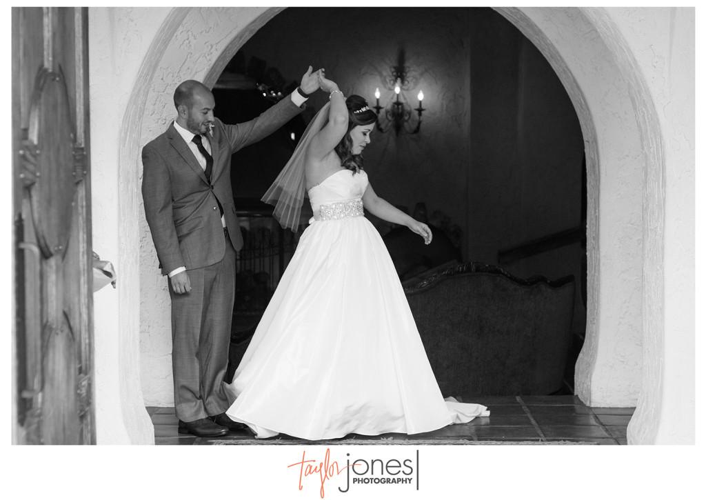 First look photo at Denver wedding, bride twirling in gown, Villa Parker