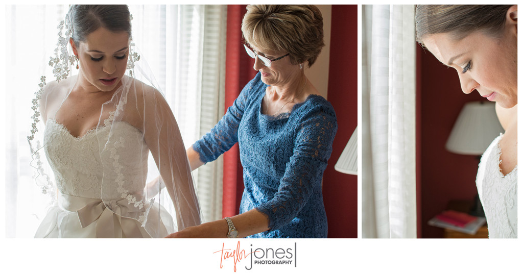 Mom and bride putting on her wedding dress