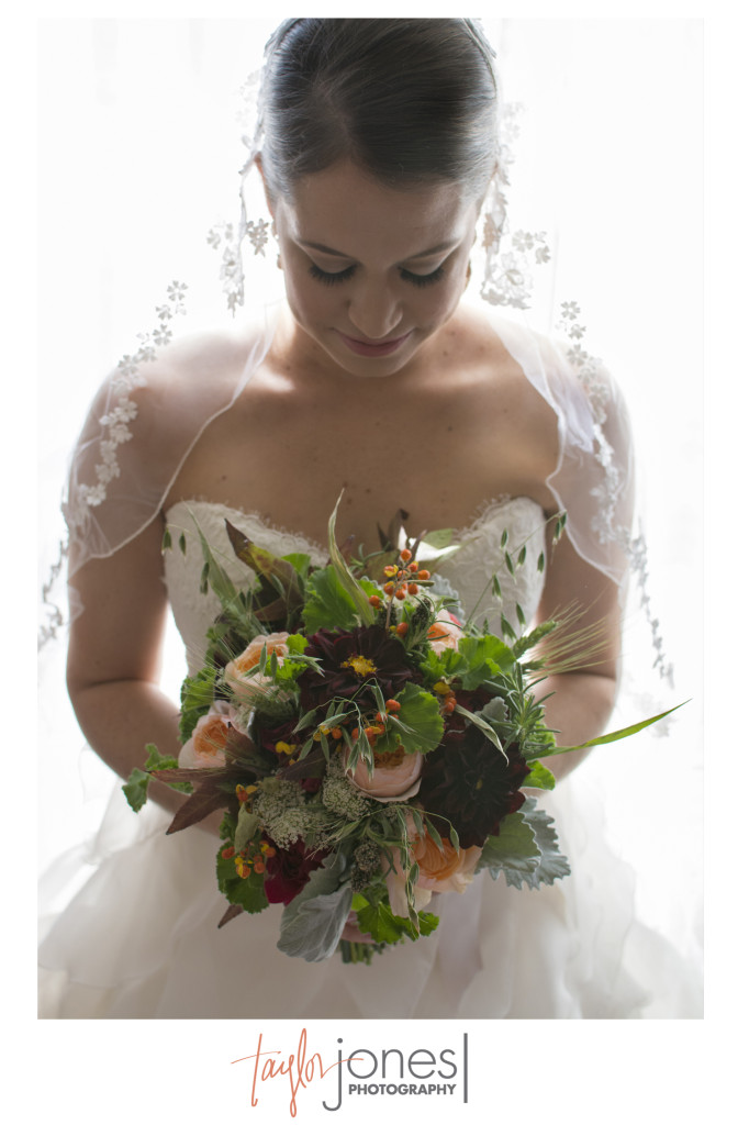 Bride with mom's veil and her bouquet