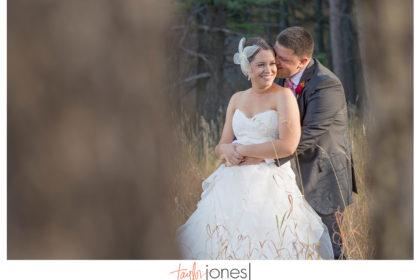Bride and groom in trees at Pines at Genesee wedding