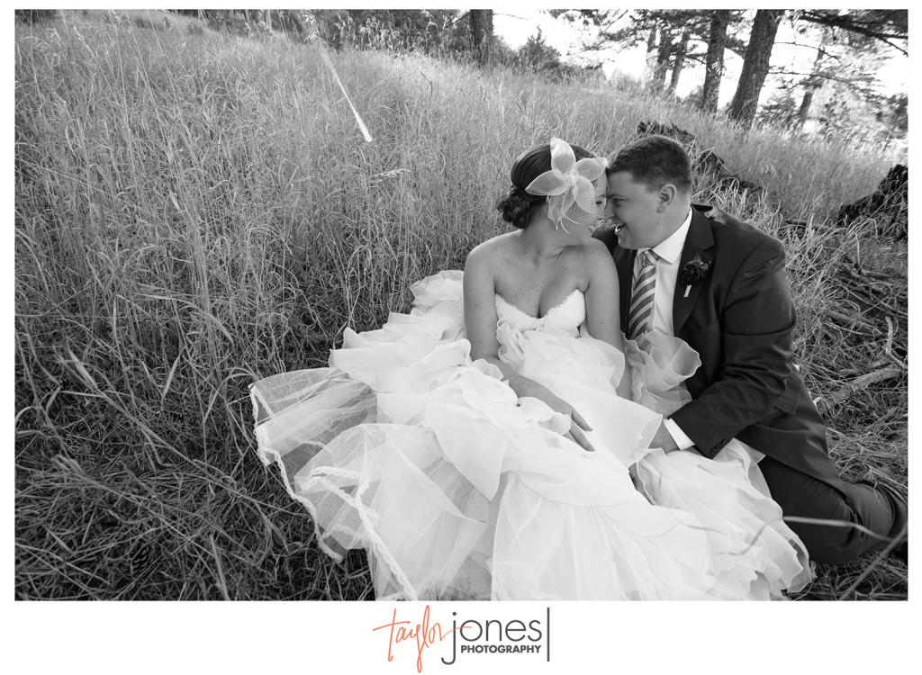 Wide angle of bride and groom at Pines at Genesee wedding in Genesee Colorado