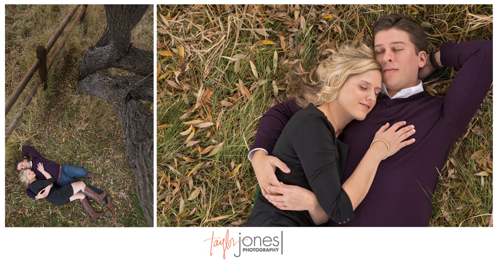 Couple laying on ground at engagement shoot in Evergreen Colorado