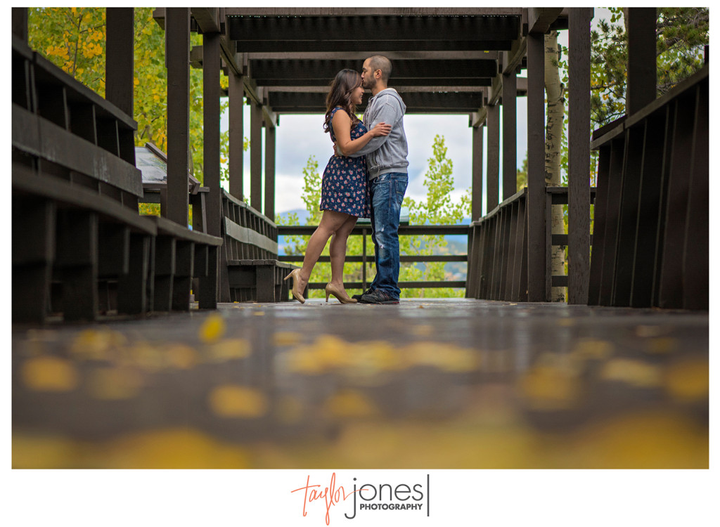 Fall leaves with couple at Golden Colorado engagement shoot
