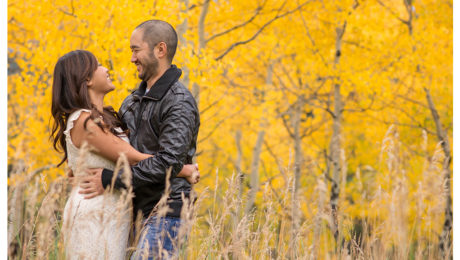 Couple in fall aspen leaves engagement shoot in Golden Gate Park
