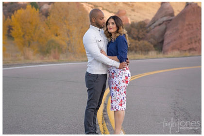 Colorado Springs wedding photographer with couple at South Valley Park at sunset, couple in the road, red rocks