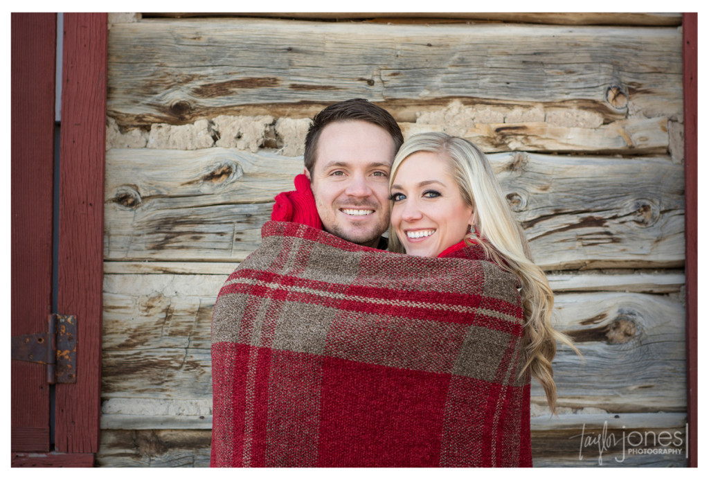 Jenny and Chris wrapped in a red blanket