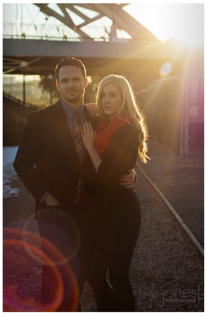Lens flare on railroad tracks at engagement shoot