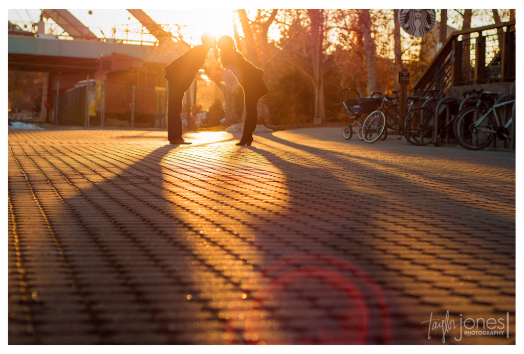 Lens flare at sunset in downtown Denver engagement shoot photographer