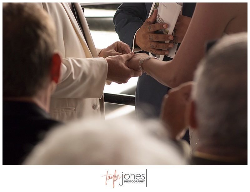 Bride and groom holding hands during Ceremony at Denver Clock Tower wedding
