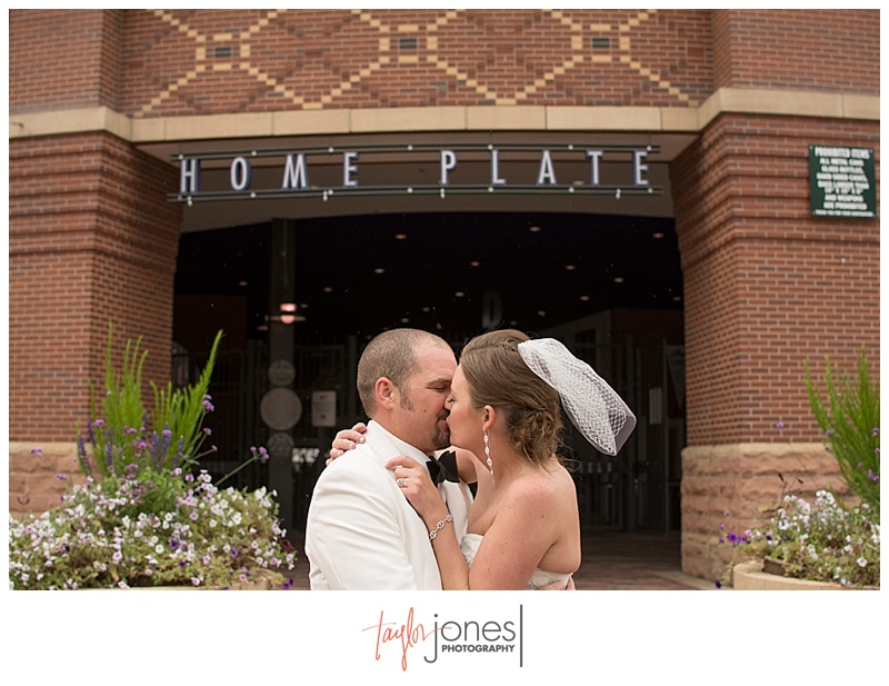 Bride and groom portraits downtown Denver at Denver Clock Tower wedding, at Coors Field