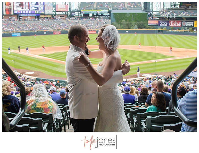 Bride and groom portraits downtown Denver at Denver Clock Tower wedding, Coors Field