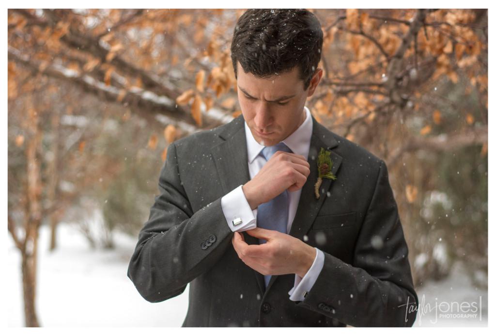 Groom portraits at winter wedding