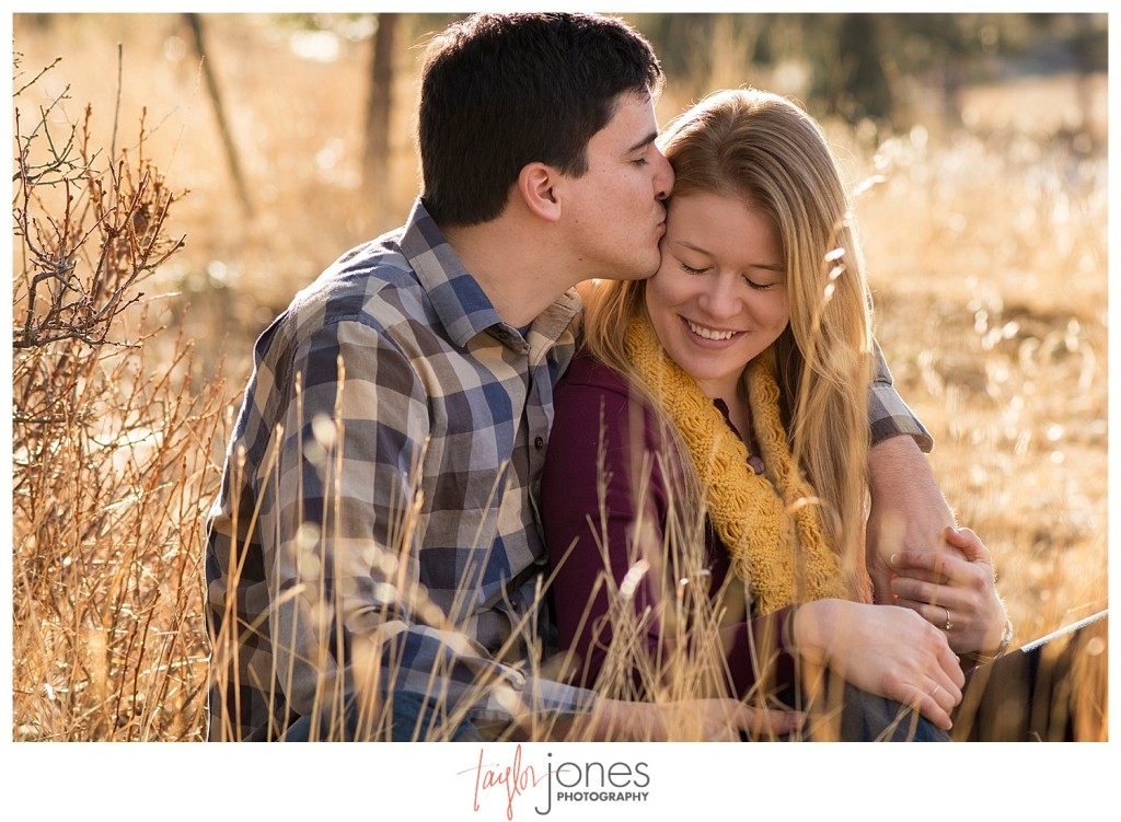 Couple kissing at engagement shoot in Evergreen Colorado