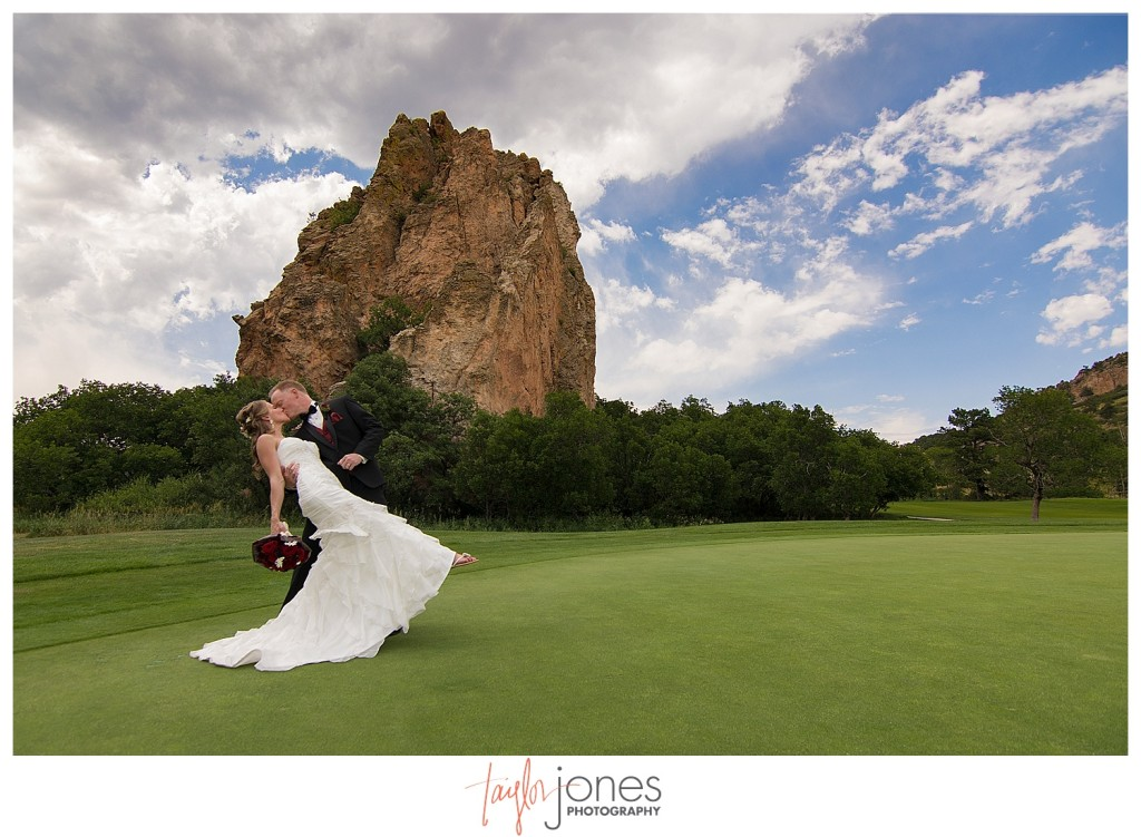 Bride and groom portraits at Perry Park wedding, red rocks in background, wide angle