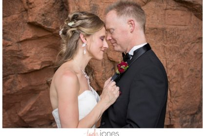 Bride and groom portraits at Perry Park wedding with red rocks