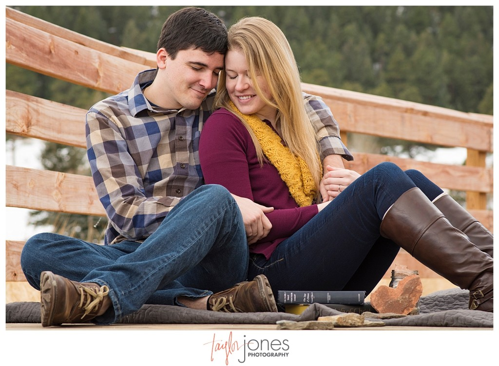 Couple sitting on a dock in Evergreen