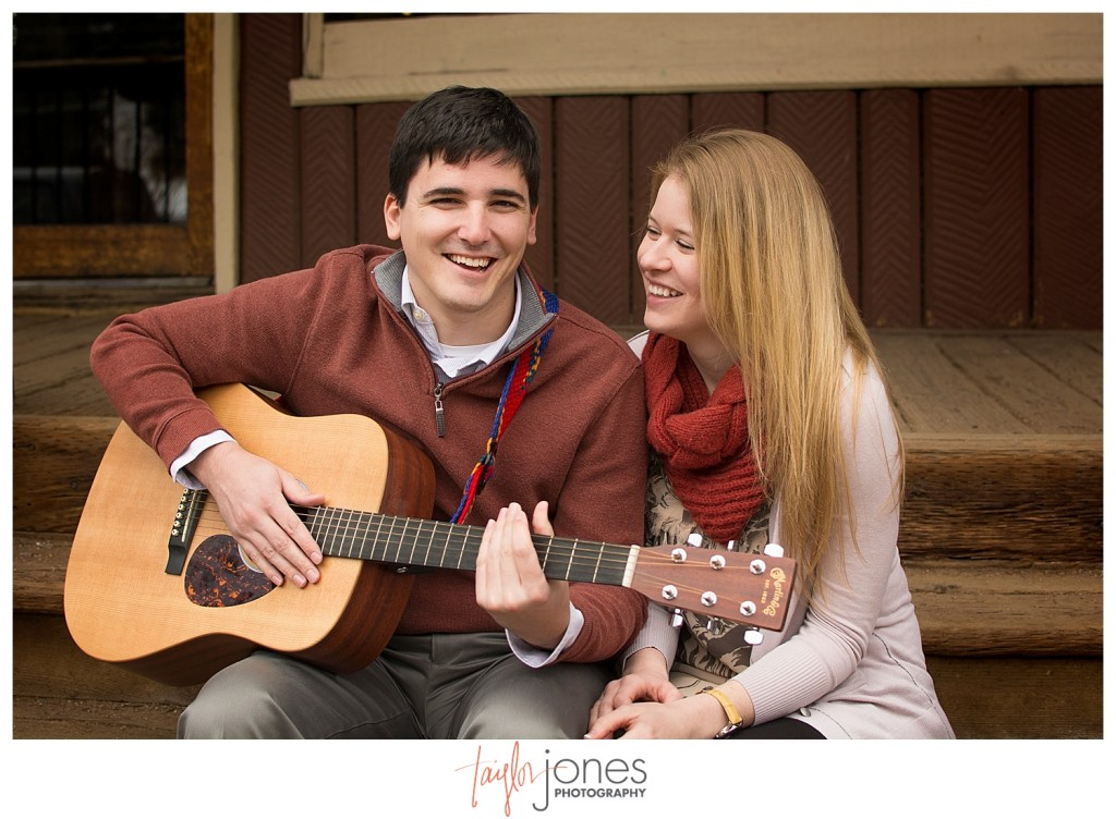 Couple playing guitar at Engagement shoot in downtown Evergreen