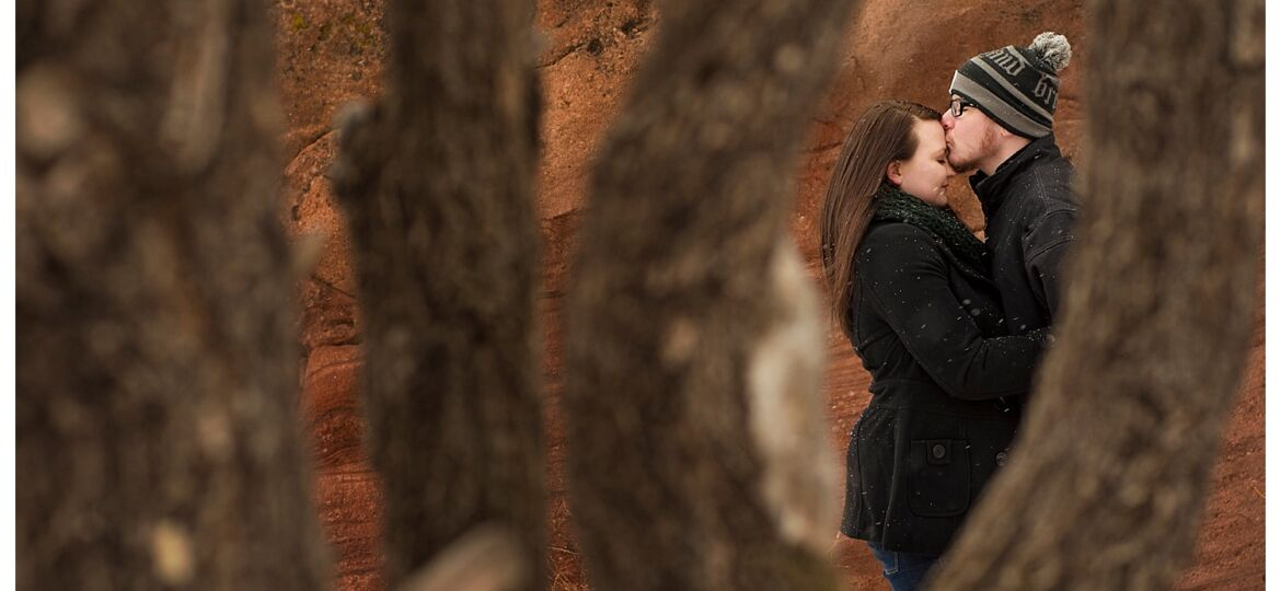 Through the trees at Red Rocks engagement shoot