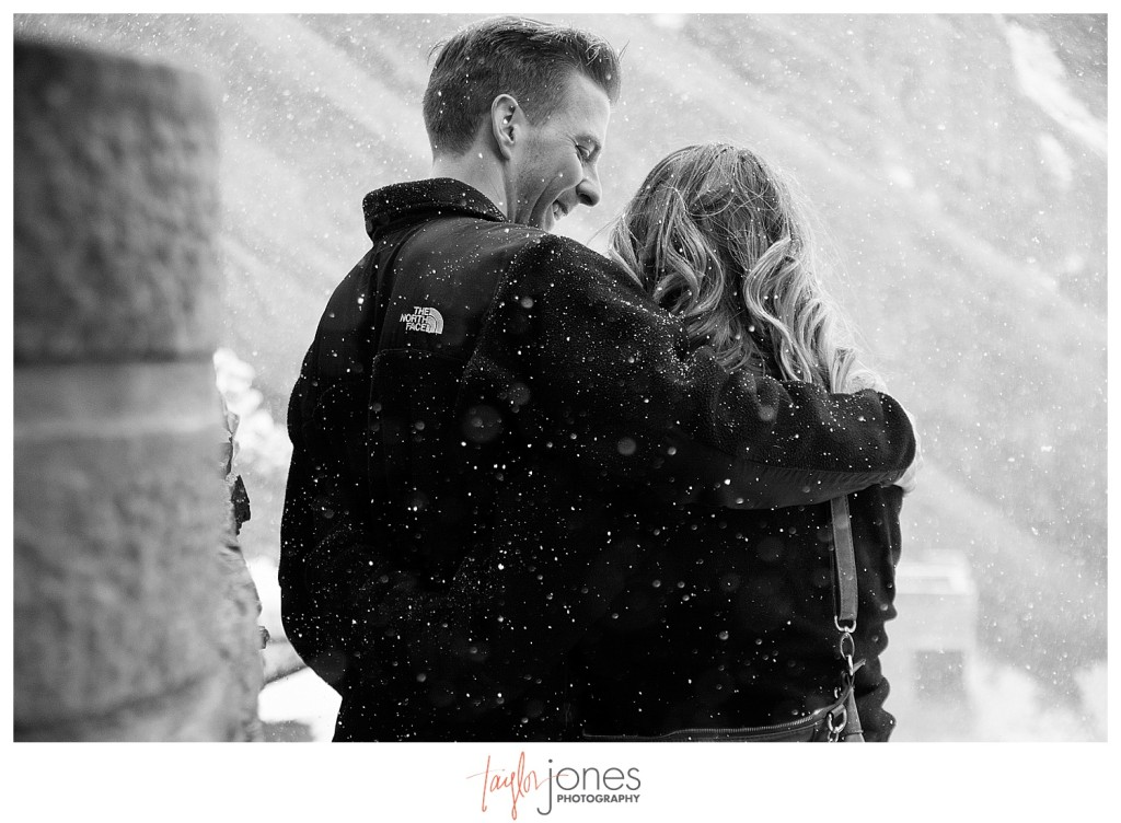 Couple together at Red Rocks winter proposal