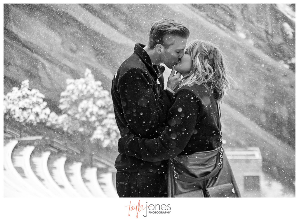 Black and white of couple kissing at Red Rocks winter proposal