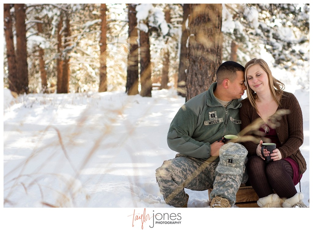 Couple drinking hot cocoa in the winter at Mt. Falcon in Indian Hills Colorado, Army couple