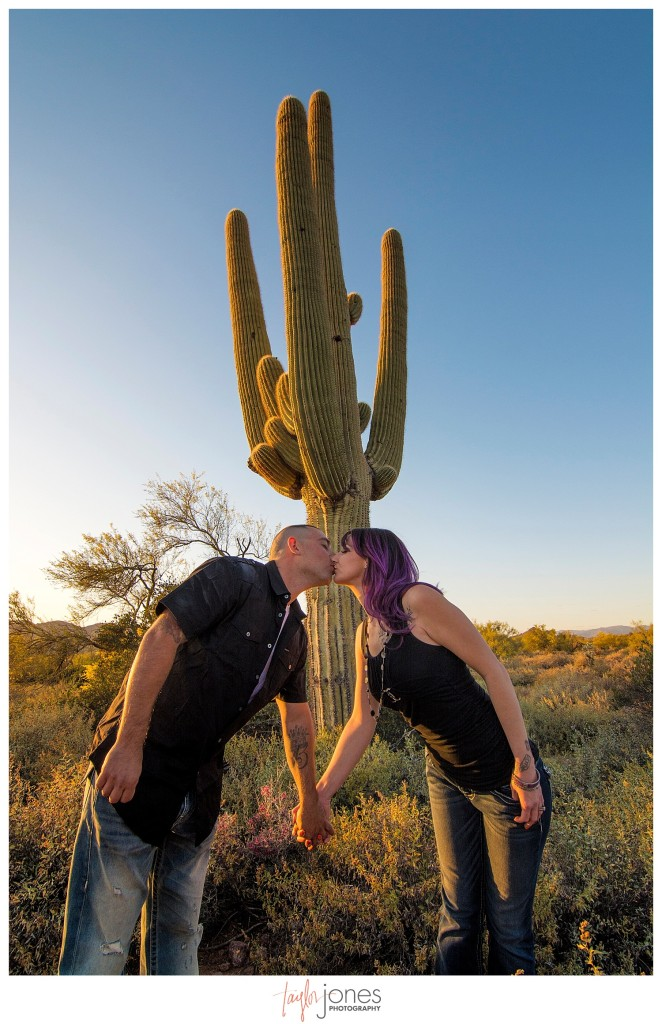 Couple kissing by cactus
