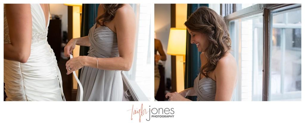 Maid of honor at Denver wedding, lacing up the brides dress