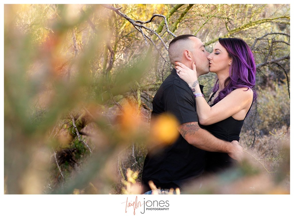 Couple kissing in cactus in Phoenix Arizona at Lost Dutchman State Park