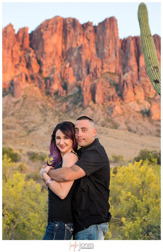 Couple kissing at engagement shoot, the Superstition Mountains