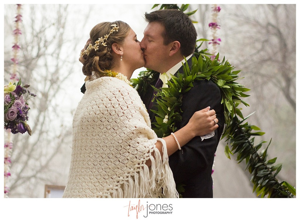 First kiss at Pines at Genesee wedding ceremony