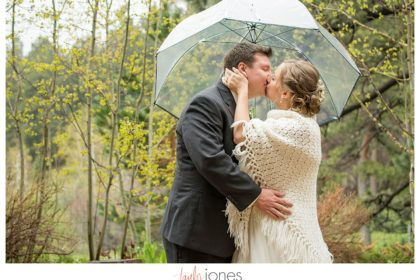Nick and Kathleen bride and groom portraits with umbrella at Pines at Genesee wedding