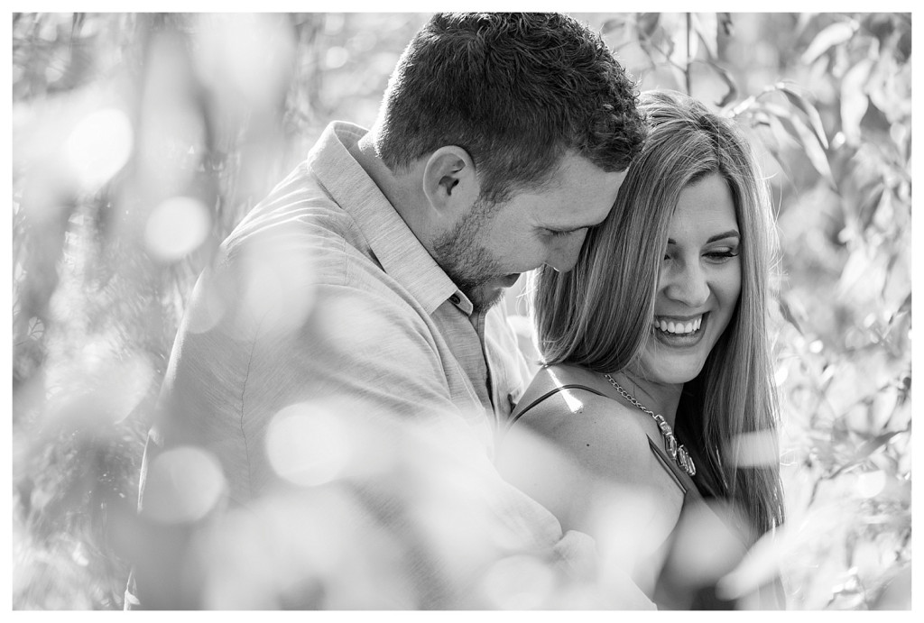 Colorado engagement shoot at Lair O the Bear couple laughing black and white