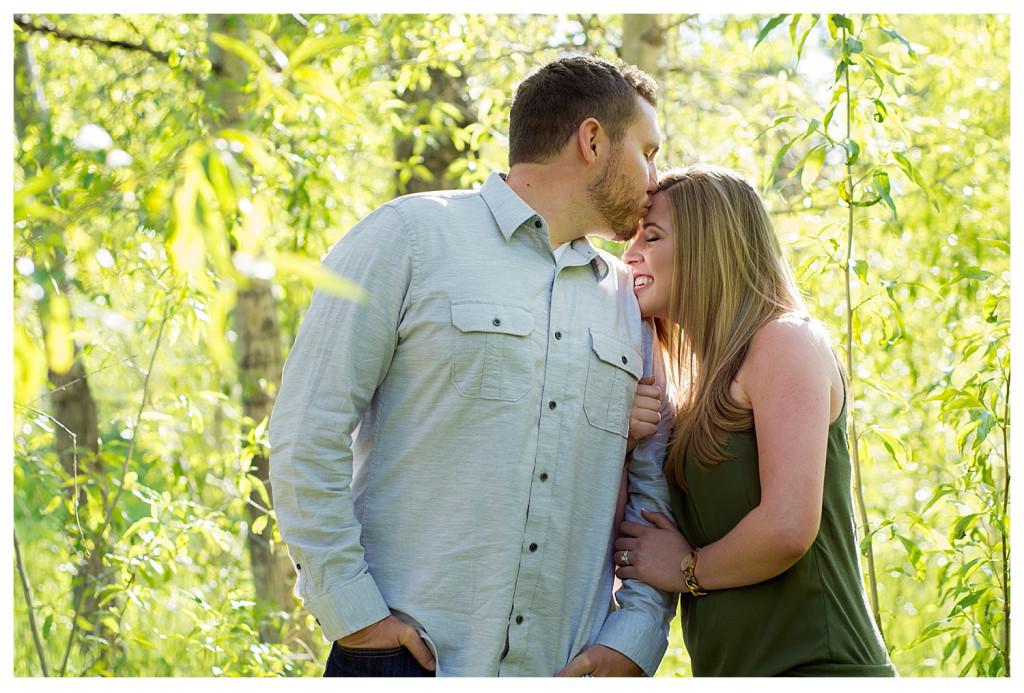 Colorado engagement shoot at Lair O the Bear couple kissing