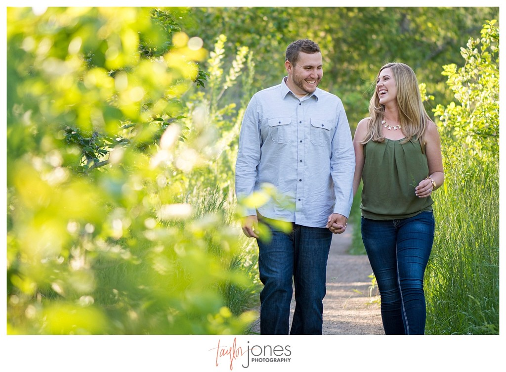 Colorado engagement shoot at Lair O the Bear couple walking down trail