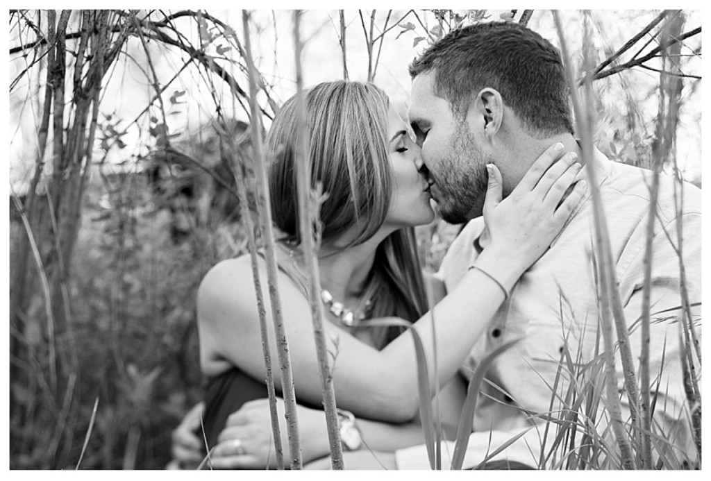 Colorado engagement shoot at Lair O the Bear couple in grass