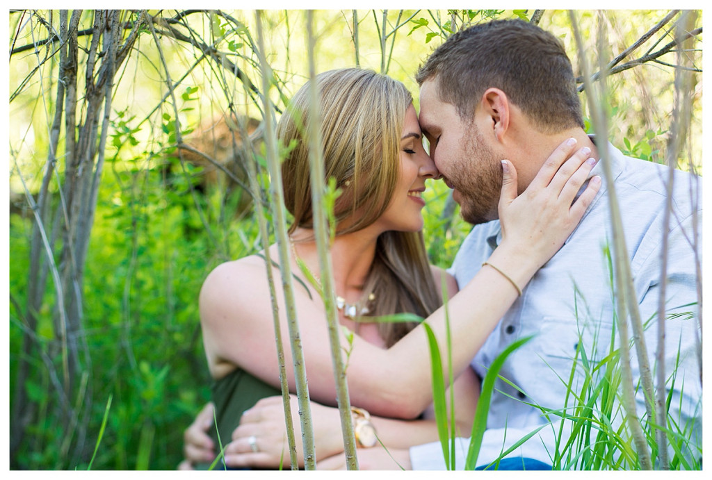 Colorado engagement shoot at Lair O the Bear couple in grass, free lensing