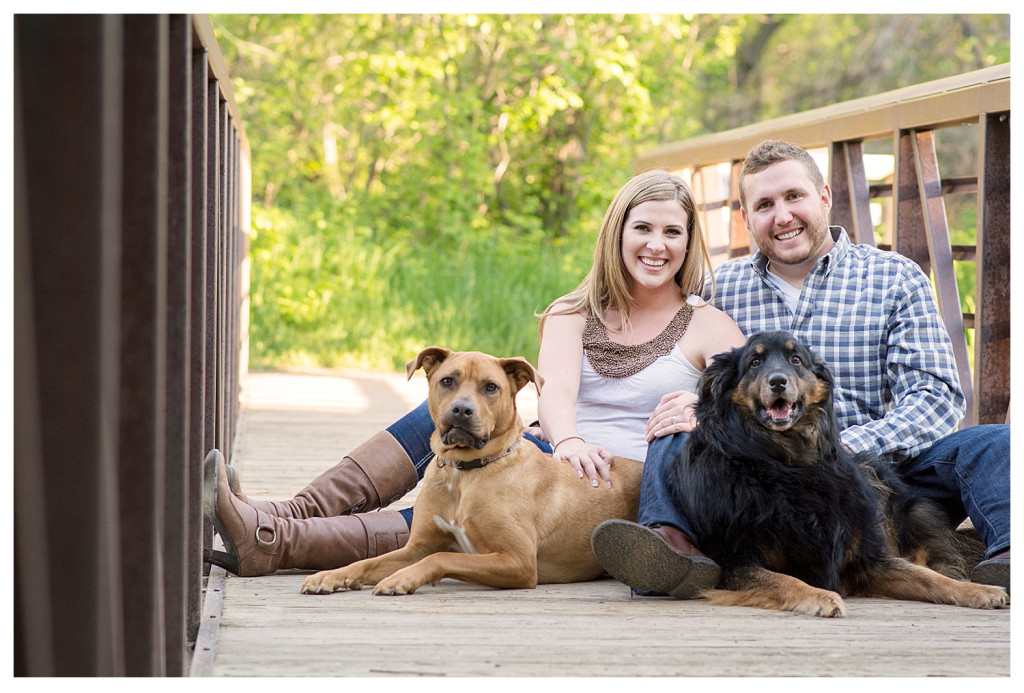 Colorado engagement shoot at Lair O the Bear couple on bridge with dogs
