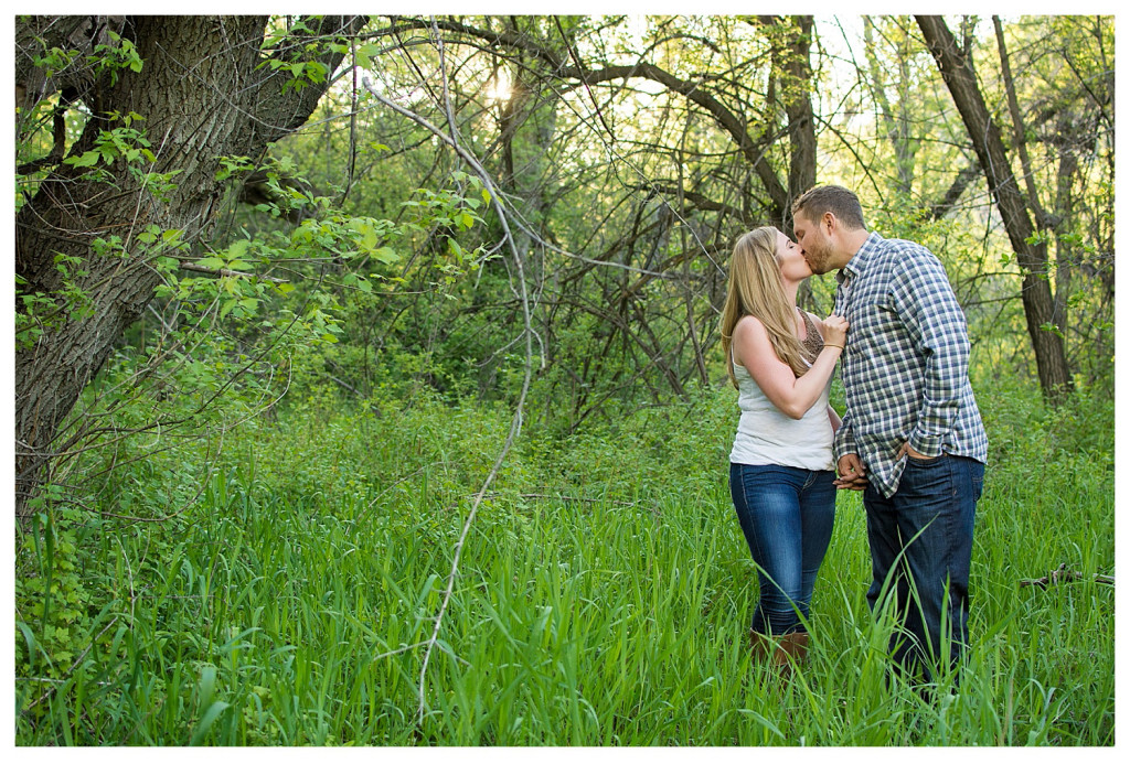 Colorado engagement shoot at Lair O the Bear couple dancing standing in field
