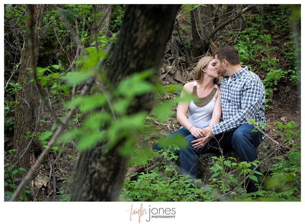 Colorado engagement shoot at Lair O the Bear couple dancing standing in field on rocks