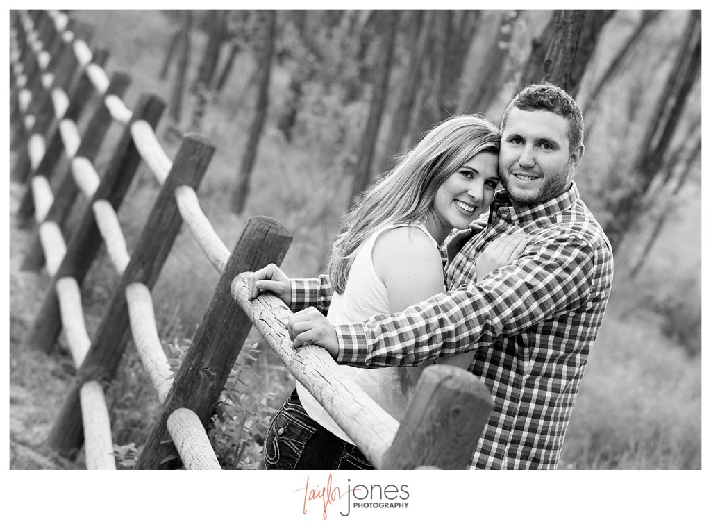 Colorado engagement shoot at Lair O the Bear couple kissing on a fence